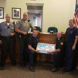 "The City of Fort Wright police and fire fighters were recognized on Wednesday, September 7, 2016 courtesy of Cash Express of Ludlow. The script on the cake reads, ""You're All Our Heroes - Thanks for All You Do""."